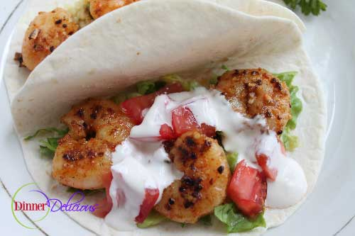 shrimp tacos with lettuce and tomatoes