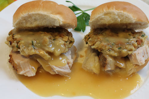 leftover hot turkey and stuffing sandwiches with gravy on a plate