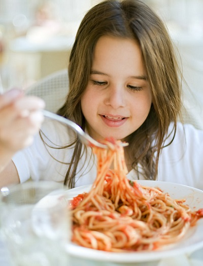 kid eating meatless sauce