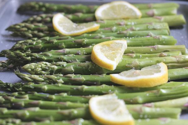 fresh asparagus on a baking sheet