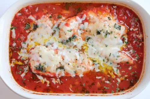 Healthy Chicken Parmesan baked in tomato sauce