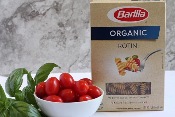 fresh tomatoes and basil in caprese pasta salad