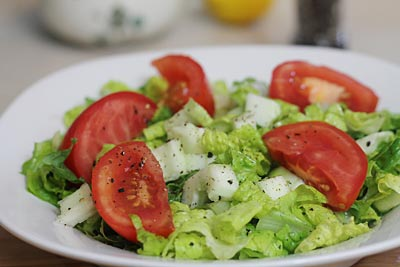 basic tossed salad with lettuce, cucumber and tomatoes