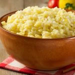 easy garlic rice with onions and Parmesan Cheese