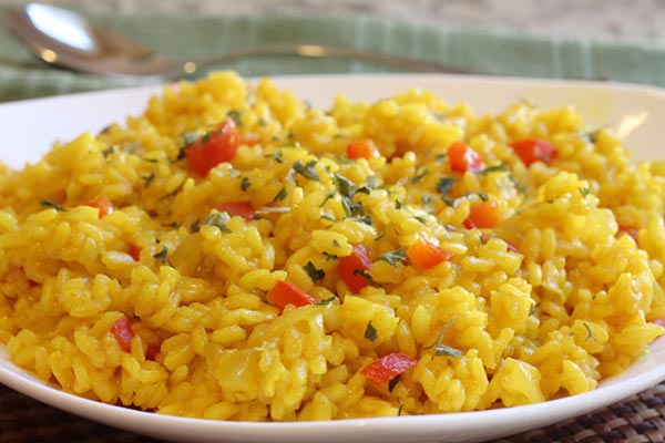 picture of yellow rice with red pepper