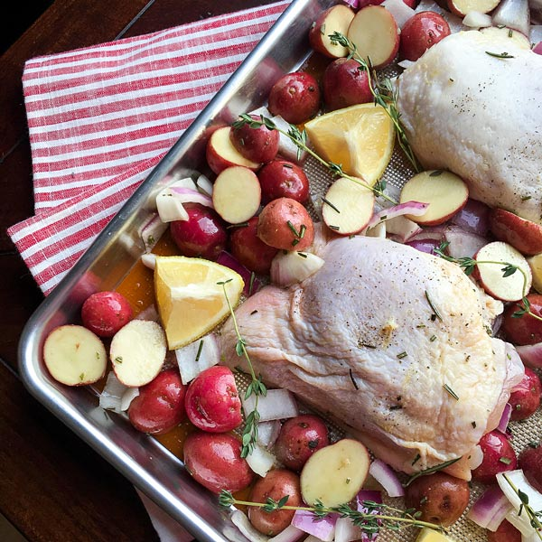 Raw Chicken ready to be roasted on a sheet pan