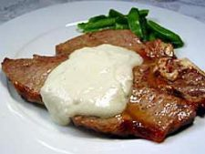 porterhouse steak topped with sauce