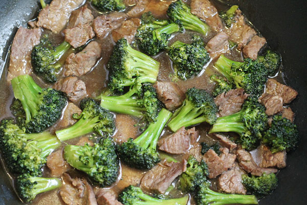 beef and broccoli in the skillet with sauce
