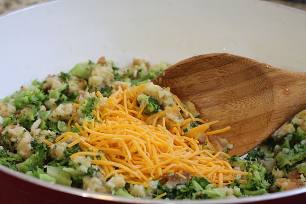 mixing the cheese with broccoli and stuffing