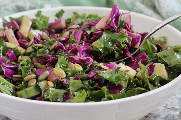 kale and red cabbage salad in a bowl