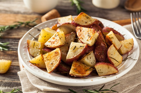 Oven Roasted RedSkin Potatoes with Herbs on a plate