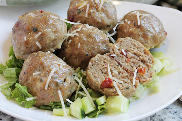 turkey pesto meatballs over a bed of greens