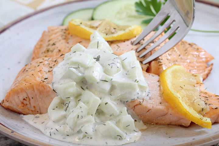 Easy Salmon with Cucumber Dill Sauce on a plate with a fork