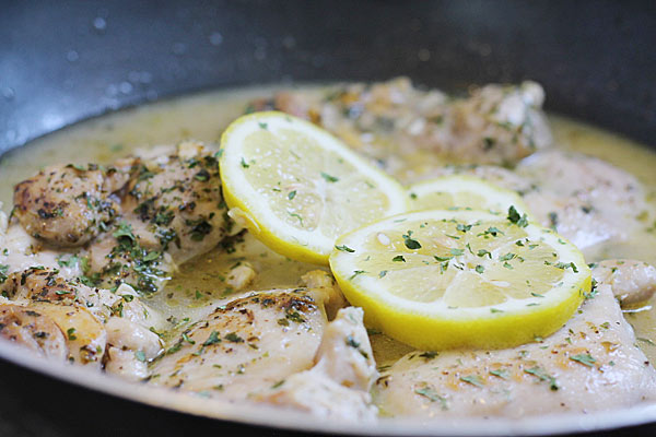 lemon slices on top of the chicken thighs.