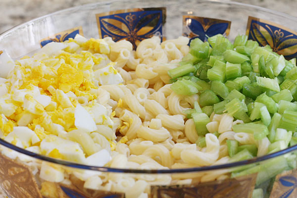 eggs, macaroni and celery in a bowl