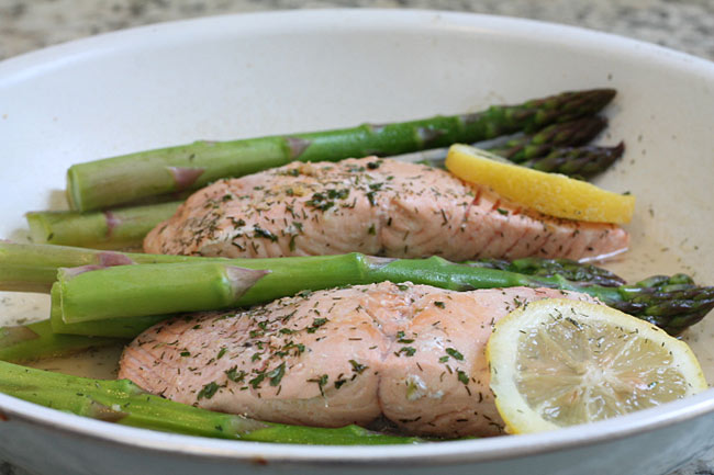 salmon pan poached along with fresh asparagus and lemon