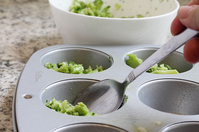 spoon buttered broccoli into muffin cups