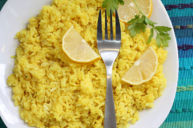 Instant Pot Lemon Rice on a dish with a fork