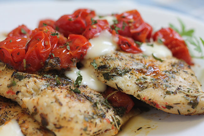 Tuscan Chicken with tomatoes and cheese on a plate