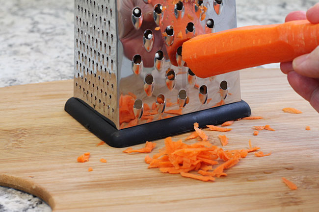grating carrots for chicken and rice soup