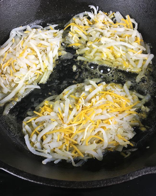 hash brown poatoes frying in the skillet